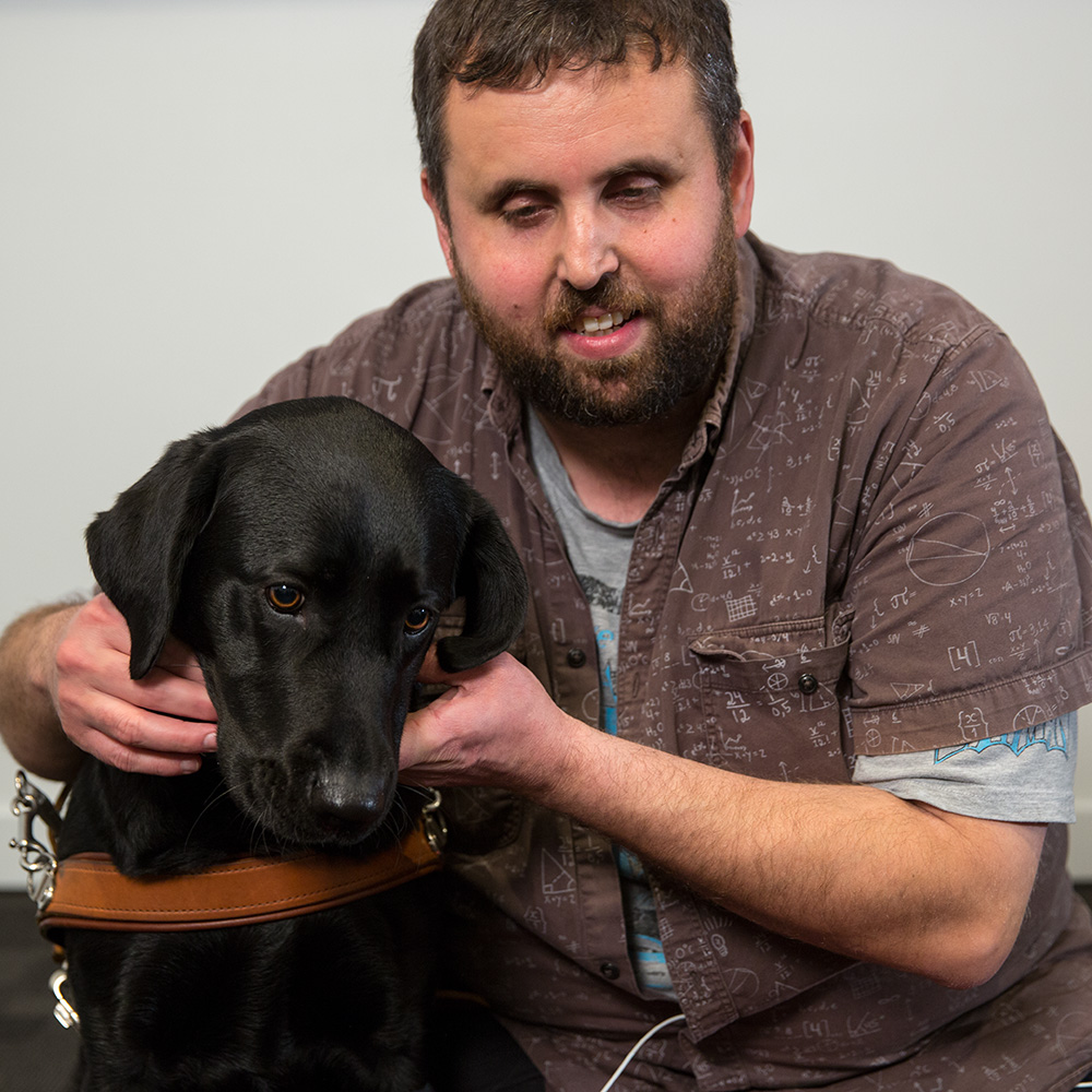 AFDO NDIS Champion Danny Noonan with his guide dog Ellie.