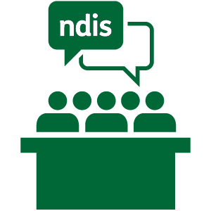 A group of people at a table talking about the NDIS