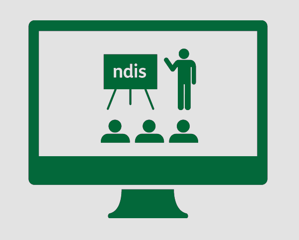 A monitor with a person presenting information about the NDIS to a group.